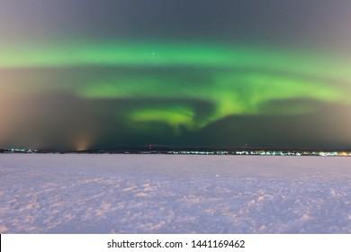 Green northern lights in Rovaniemi (Lapland, Finland)