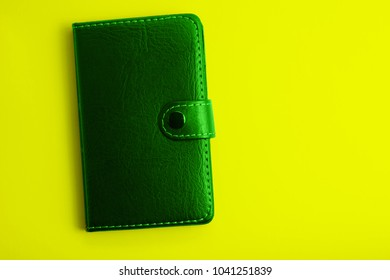 green notepad on a yelow background