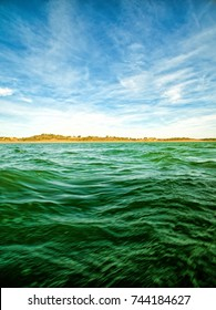 Green Ocean Waves and Blue Sky with Clouds, summer sunny day