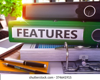Green Office Folder with Inscription Features on Office Desktop with Office Supplies and Modern Laptop. Features Business Concept on Blurred Background. Features - Toned Image. 3D