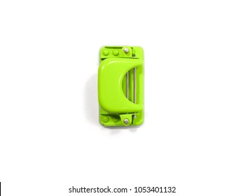 Green office paper hole puncher top view isolated on white background. free space to type text.