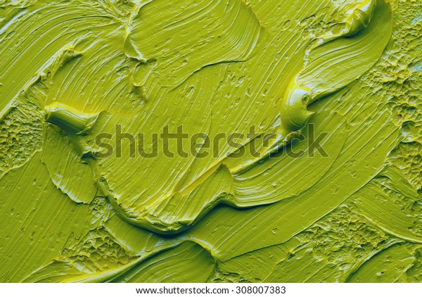 green oil paint on a palette