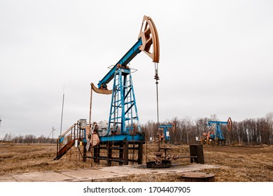 Green Oil pump oil rig energy industrial machine for petroleum crude. oil crisis. Russia pumps oil pollution