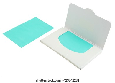 Green oil removing films with its package. Isolate white background. Clipping path included.