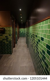 Green old fashioned bathroom tiles in public area (from 1960's)