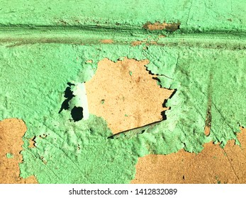 Green old flaking paint on the yellow wall. Grange texture with scratches. Vintage surface. background in warm colors.