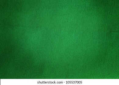 Green old grunged textile for the use of a background