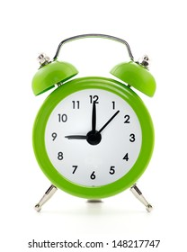 Green  old style alarm clock isolated on white background