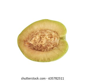 Green olive cut in half isolated over the white background