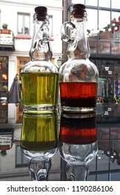 Green olive oil and hot chilli olive oil bottles in a cozy pizzeria in Tbilisi