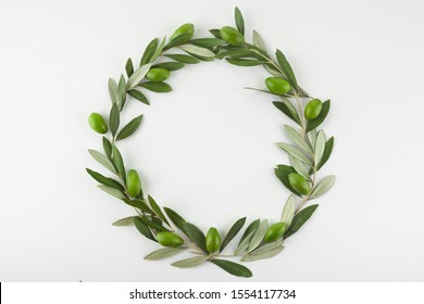 Green olive wreath on white background. Top view