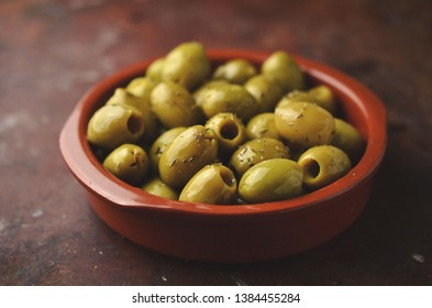 Green olives in clay bowl
