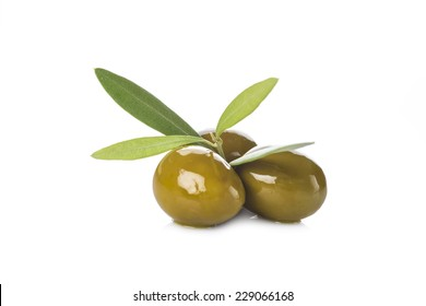 Green olives with leaves isolated on a white background
