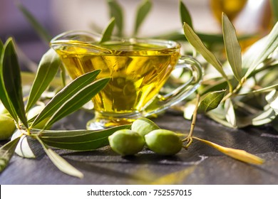 green olives with olive oil on a dark background