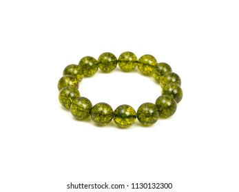 Green Olivine or Green Peridote lucky stone bracelet Beads with white isolated background
