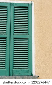 Green on yellow window shutters