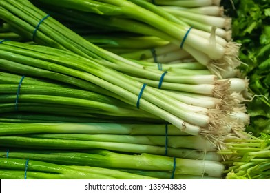 green onion with chives on display
