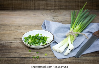 Green Onion on wood background
