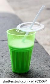 A green opened milkshake