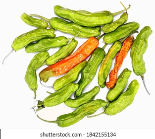 Green and orange drying chili peppers, natural organic with wrinkled skins. Isolated on white.