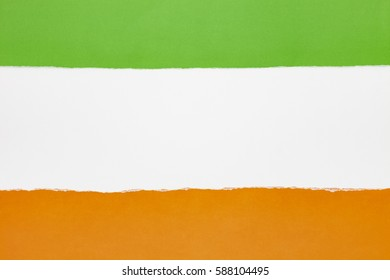 green and orange torn paper on white background