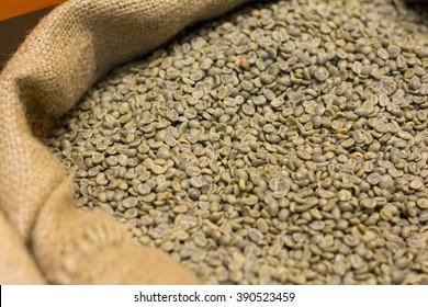 green organic coffee beans in a sack