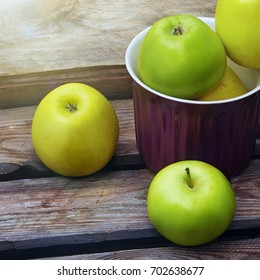 Green organic healthy apples on wooden board. Healthy food