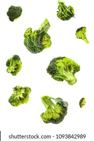 green organic isolated broccoli falling on white background with clipping path. healthy food concept