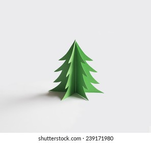 Green origami paper christmas tree on white background