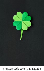 Green origami shamrock clover leaf paper background. St. Patrick's Day greeting postcard template. Space for copy, text, lettering.