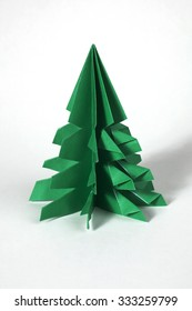 Green origami  tree. Christmas decoration.