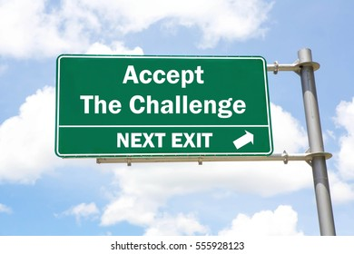Green overhead road sign with an Accept The Challenge Next Exit concept against a partly cloudy sky background.