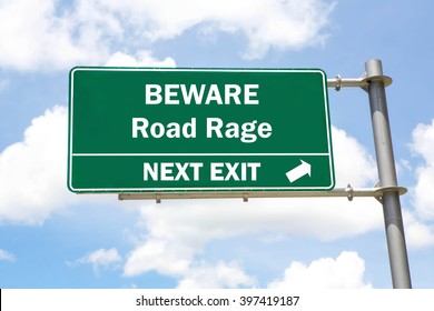 Green overhead road sign with a Beware Road Rage Next Exit concept against a partly cloudy sky background.
