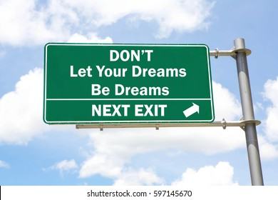 Green overhead road sign with a Don't Let Your Dreams Be Dreams Next Exit concept against a partly cloudy sky background.
