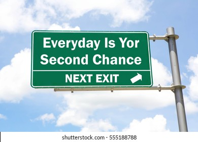 Green overhead road sign with an Everyday Is Second Chance Next Exit concept against a partly cloudy sky background.