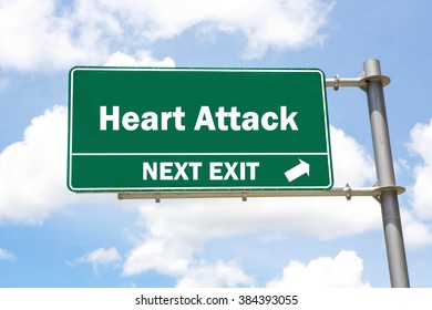 Green overhead road sign with a Heart Attack Next Exit concept against a partly cloudy sky background.