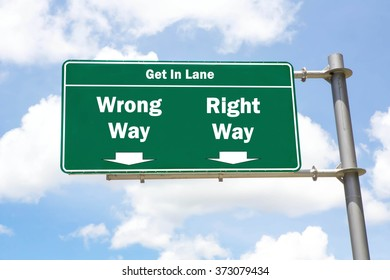 Green overhead road sign with the instruction to get in lane with a Wrong Way or Right Way concept against a partly cloudy sky background.