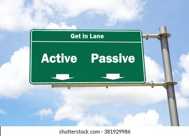 Green overhead road sign with the instruction to get in lane with an Active or Passive concept against a partly cloudy sky background.