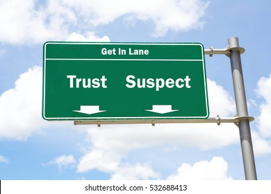 Green overhead road sign with the instruction to get in lane with a Trust or Suspect concept against a partly cloudy sky background.