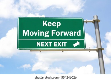Green overhead road sign with a Keep Moving Forward Next Exit concept against a partly cloudy sky background.