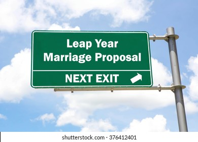 Green overhead road sign with a Leap Year Marriage Proposal Next Exit concept against a partly cloudy sky background.