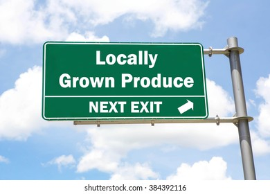 Green overhead road sign with a Locally Grown Produce Next Exit concept against a partly cloudy sky background.