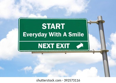 Green overhead road sign with a Start Everyday With A Smile Next Exit concept against a partly cloudy sky background.