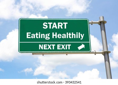 Green overhead road sign with a Start Eating Healthily Next Exit concept against a partly cloudy sky background.