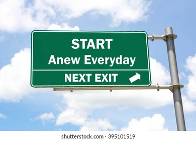 Green overhead road sign with a Start Anew Everyday Next Exit concept against a partly cloudy sky background.