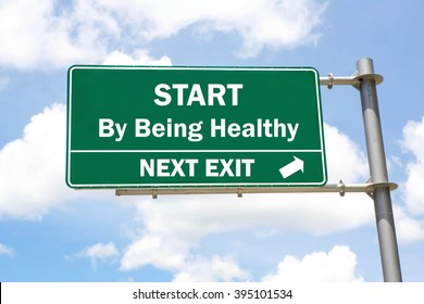 Green overhead road sign with a Start By Being Healthy Next Exit concept against a partly cloudy sky background.