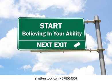 Green overhead road sign with a Start Believing In Your Ability Next Exit concept against a partly cloudy sky background.
