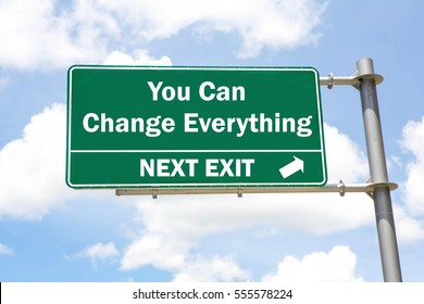 Green overhead road sign with a You Can Change Everything Next Exit concept against a partly cloudy sky background.