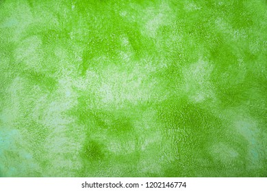 green paint cement wall , vintage wall Textured background .