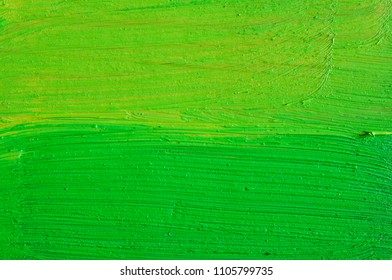 green paint on old wooden background